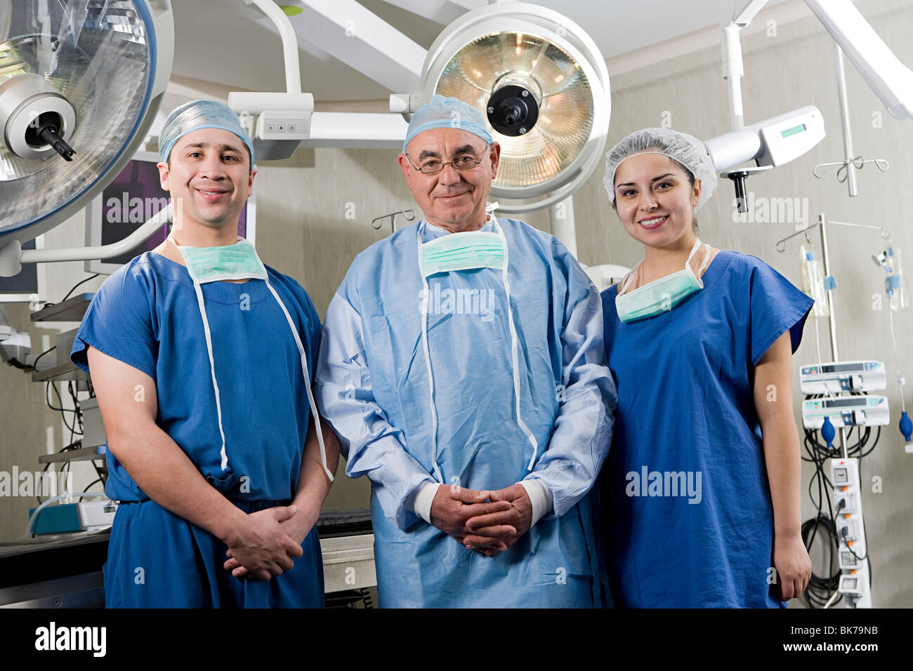 Surgeons in operating room - Stock Image