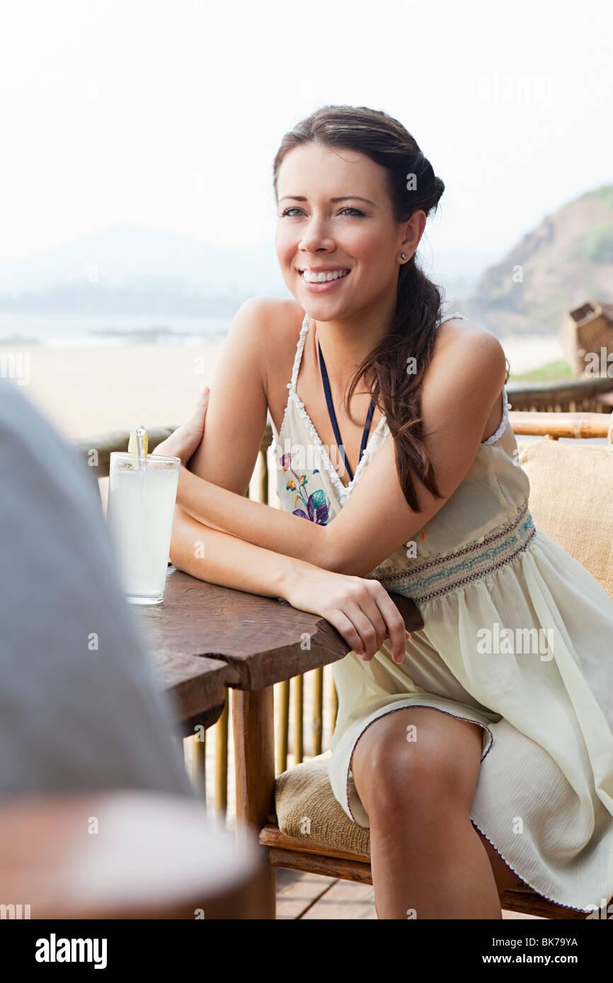 Woman at beach bar - Stock Image