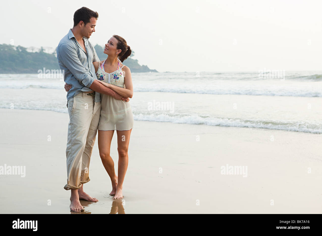 Couple by the ocean - Stock Image