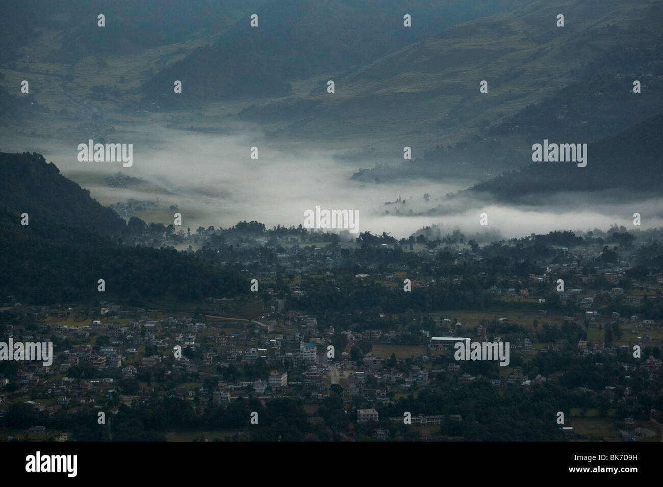 Morning mist covers the valley floor near Pokhara, Nepal on Tuesday October 27, 2009. - Stock Image