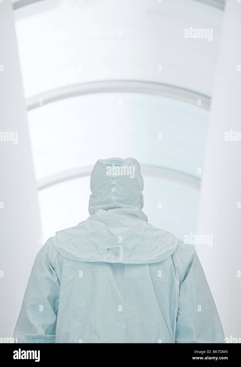 Scientist in an isolation suit - Stock Image