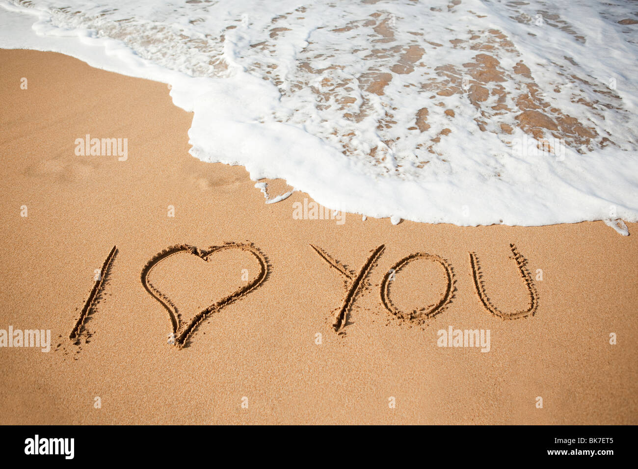I love you written in sand Stock Photo