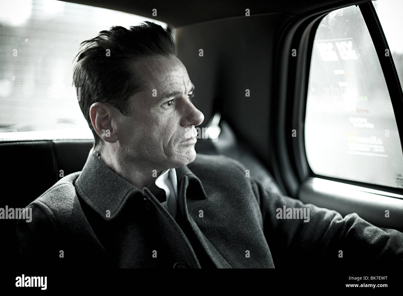 Man in taxi cab - Stock Image