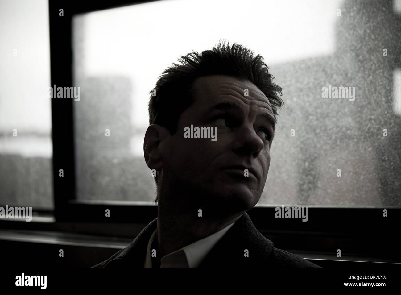 Man on staten island ferry - Stock Image