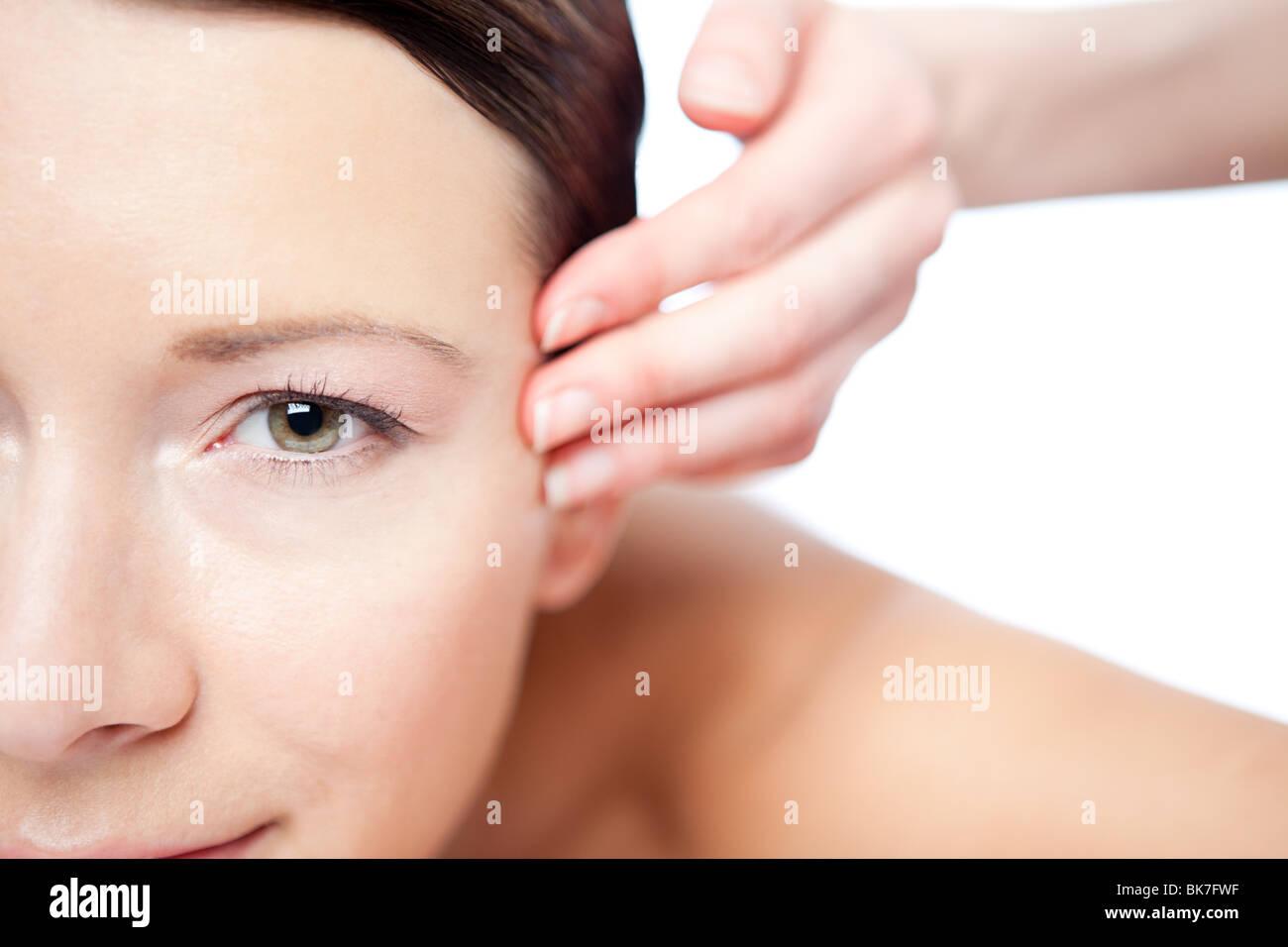 Woman having face massage Stock Photo