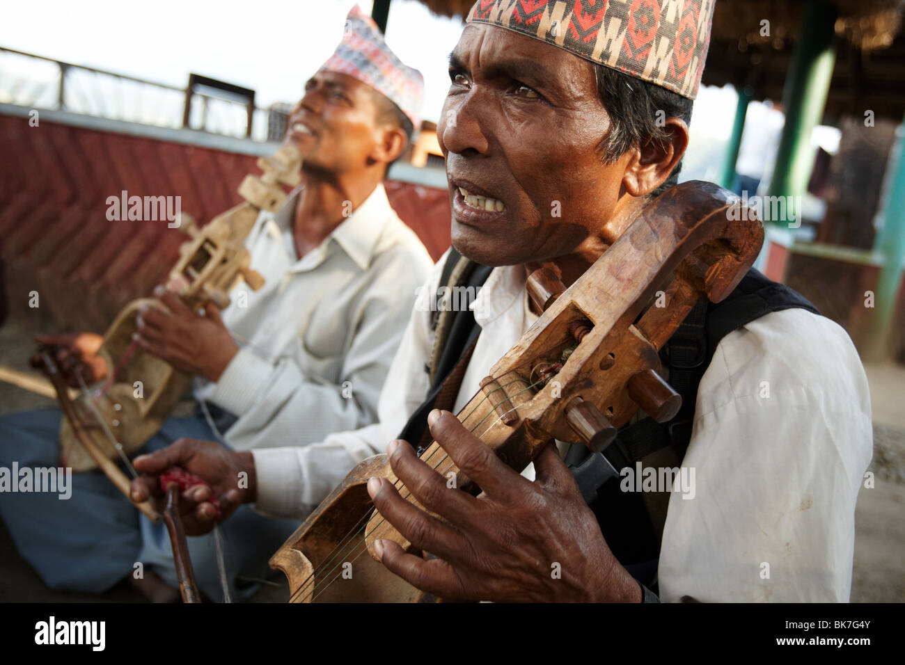 Musicians play a traditional string instrument at Begnas Lake near Pokhara, Nepal on Tuesday October 27, 2009. - Stock Image