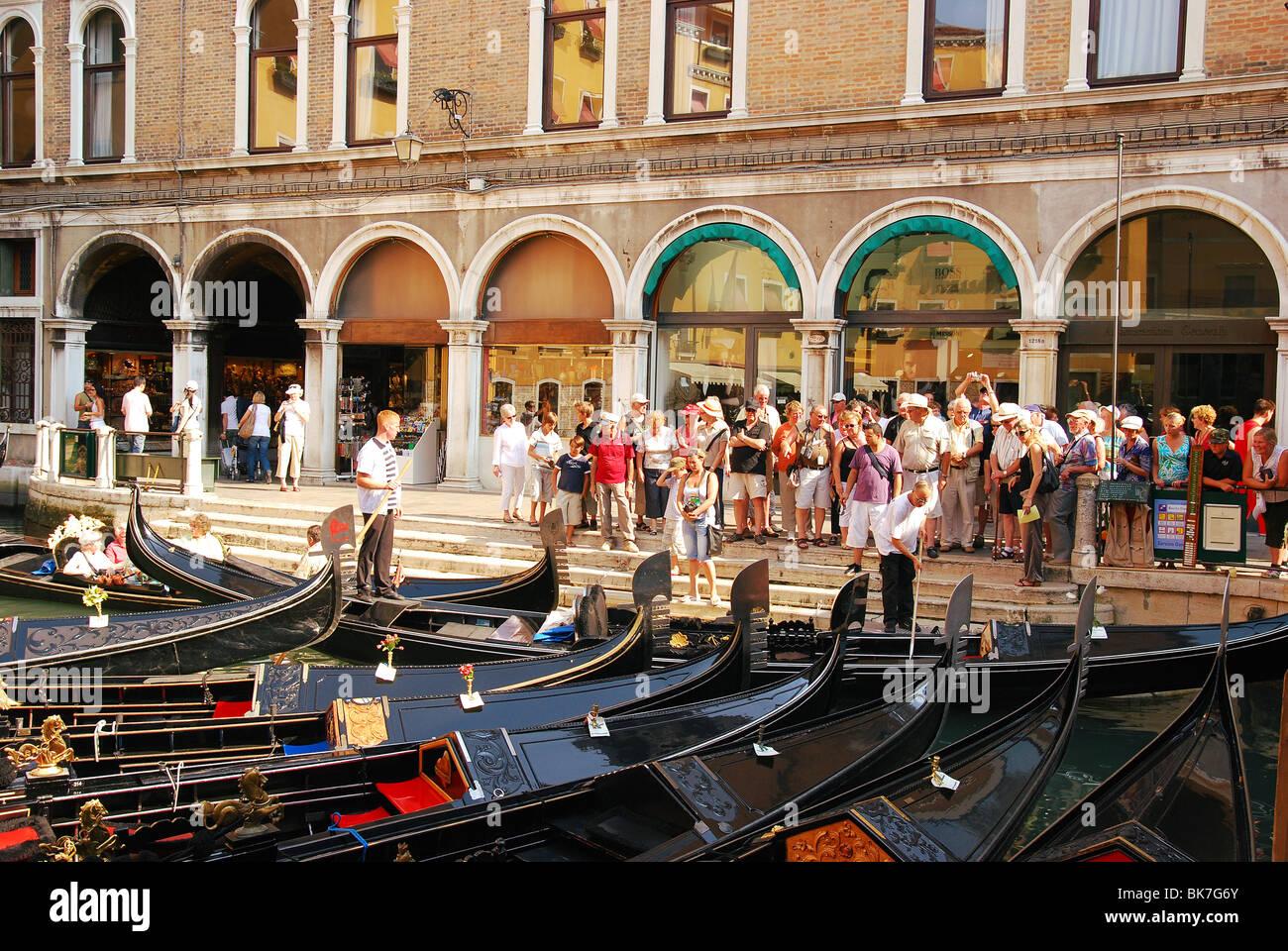 Gondolas parking in Venice. Tourists choose gondolas for traditional venetian gondola ride. Bacino Orseolo - Stock Image