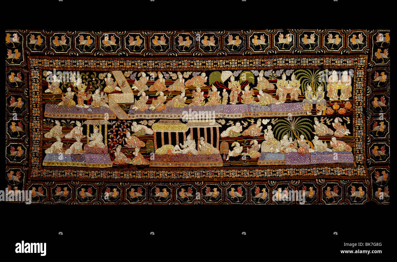 An early 20th century Burmese tapestry called Calaga, used as a curtain or backdrop, usually depicting religious - Stock Image