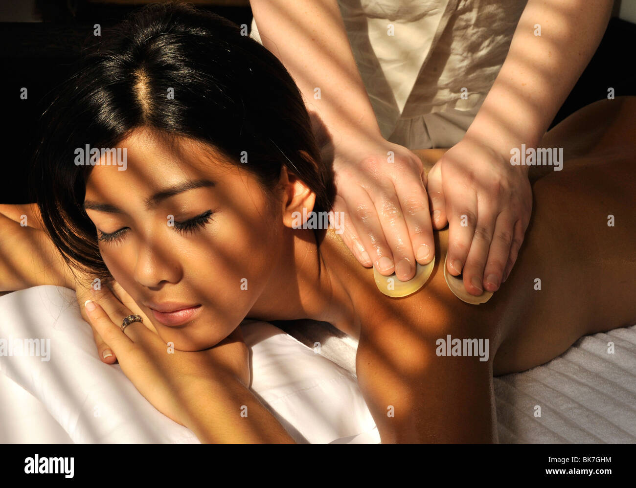 massage oil stock photos & massage oil stock images - alamy