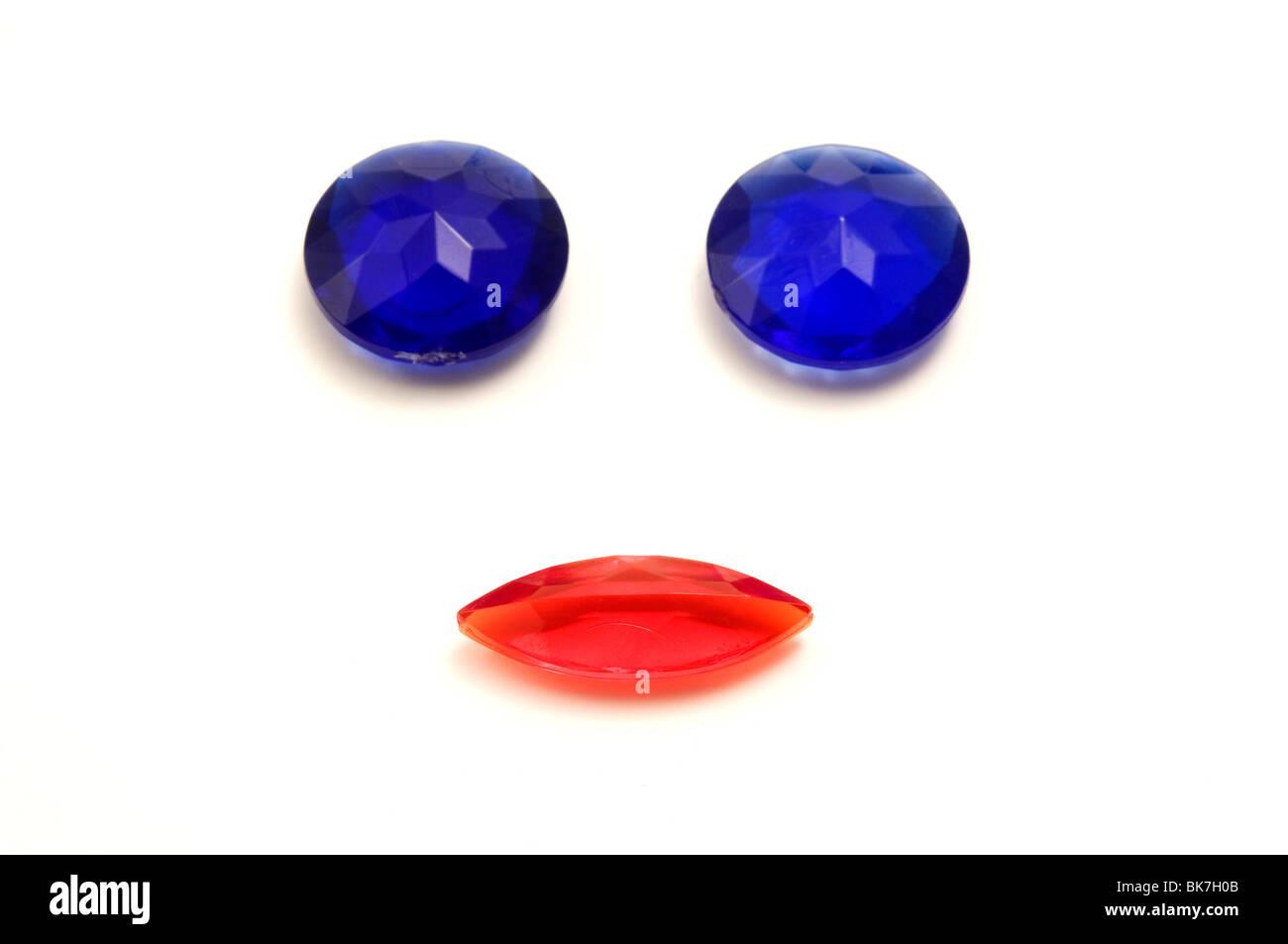 Plastic gemstones on a white background - Stock Image