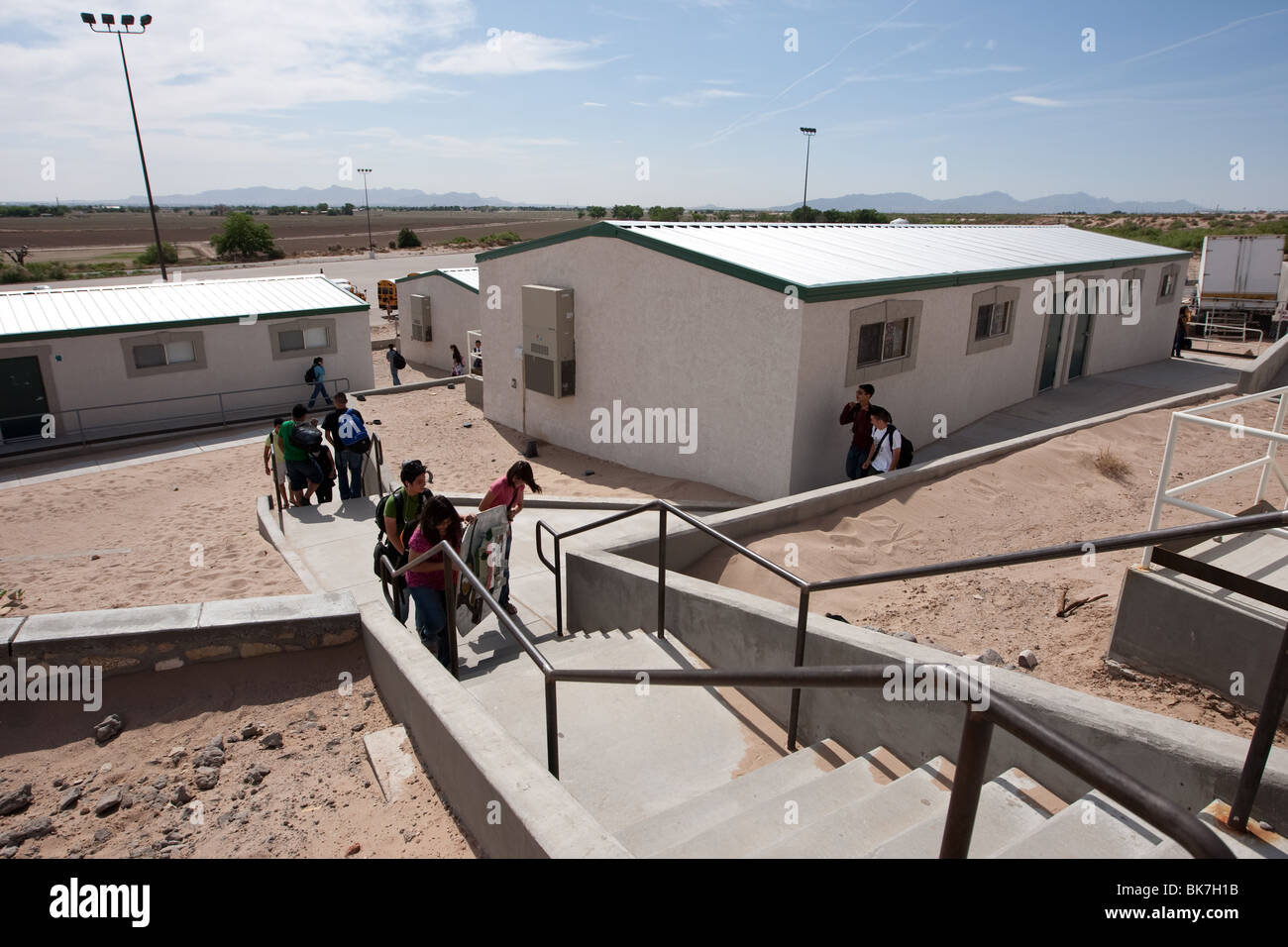 Exterior of students walking between portable buildings on campus of Mission Early College High School in El Paso, - Stock Image