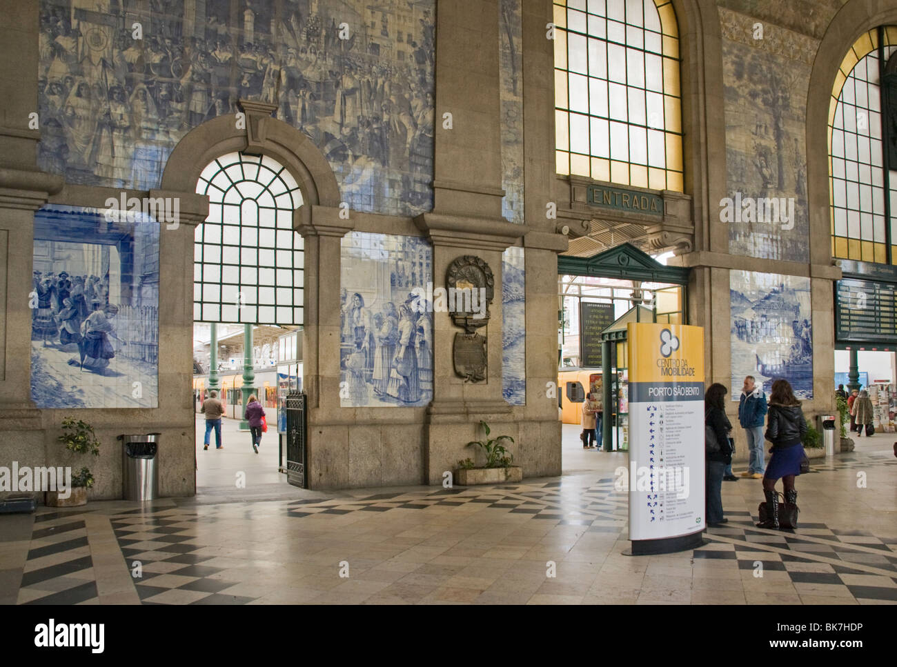 Azulejo (earthenware tiles) tile paintings cover the entry hall of Sao Bento railway station, Porto (Oporto), Portugal, - Stock Image