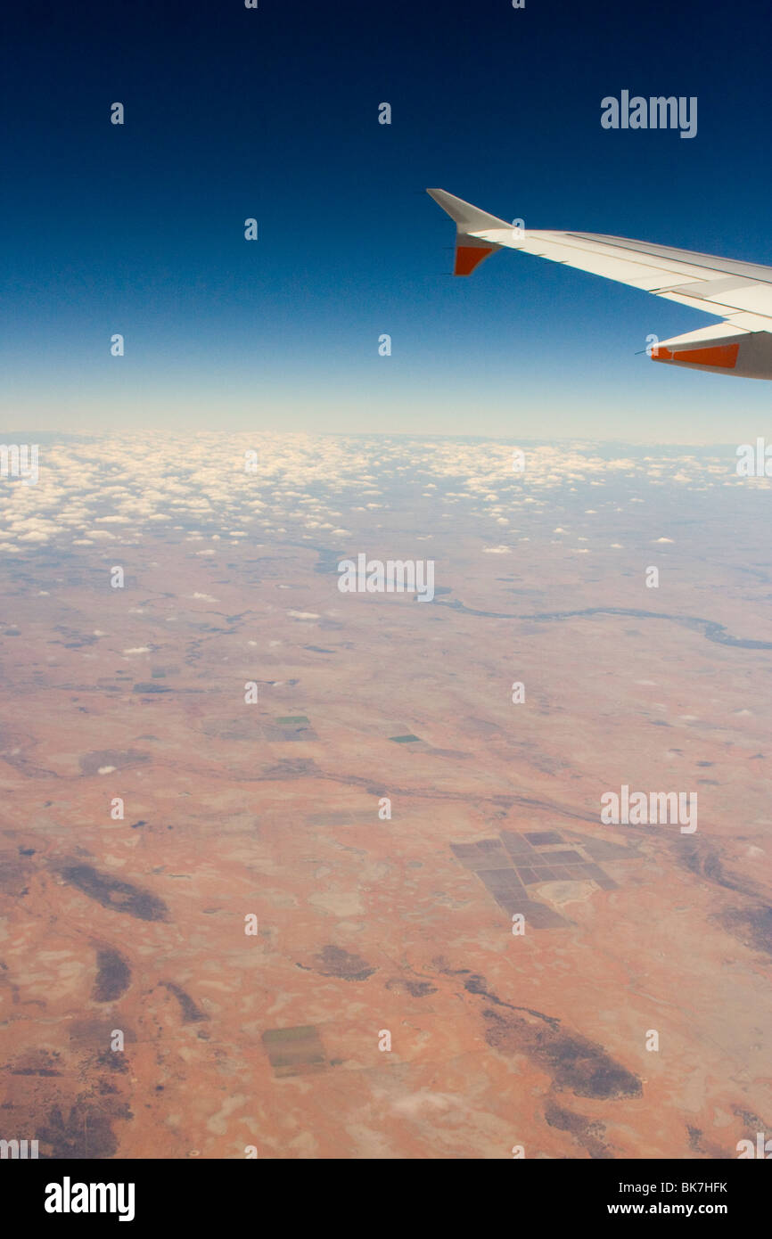 Jet Airways plane wing over Australian outback - Stock Image
