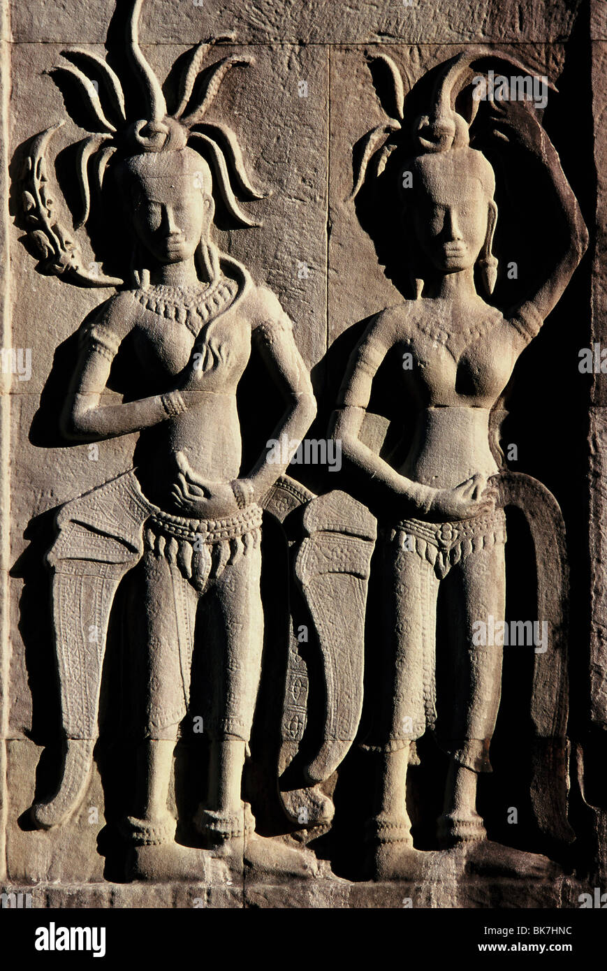 Detail of reliefs from the early 12th century with later additions, Angkor Wat, Angkor, UNESCO World Heritage Site, - Stock Image