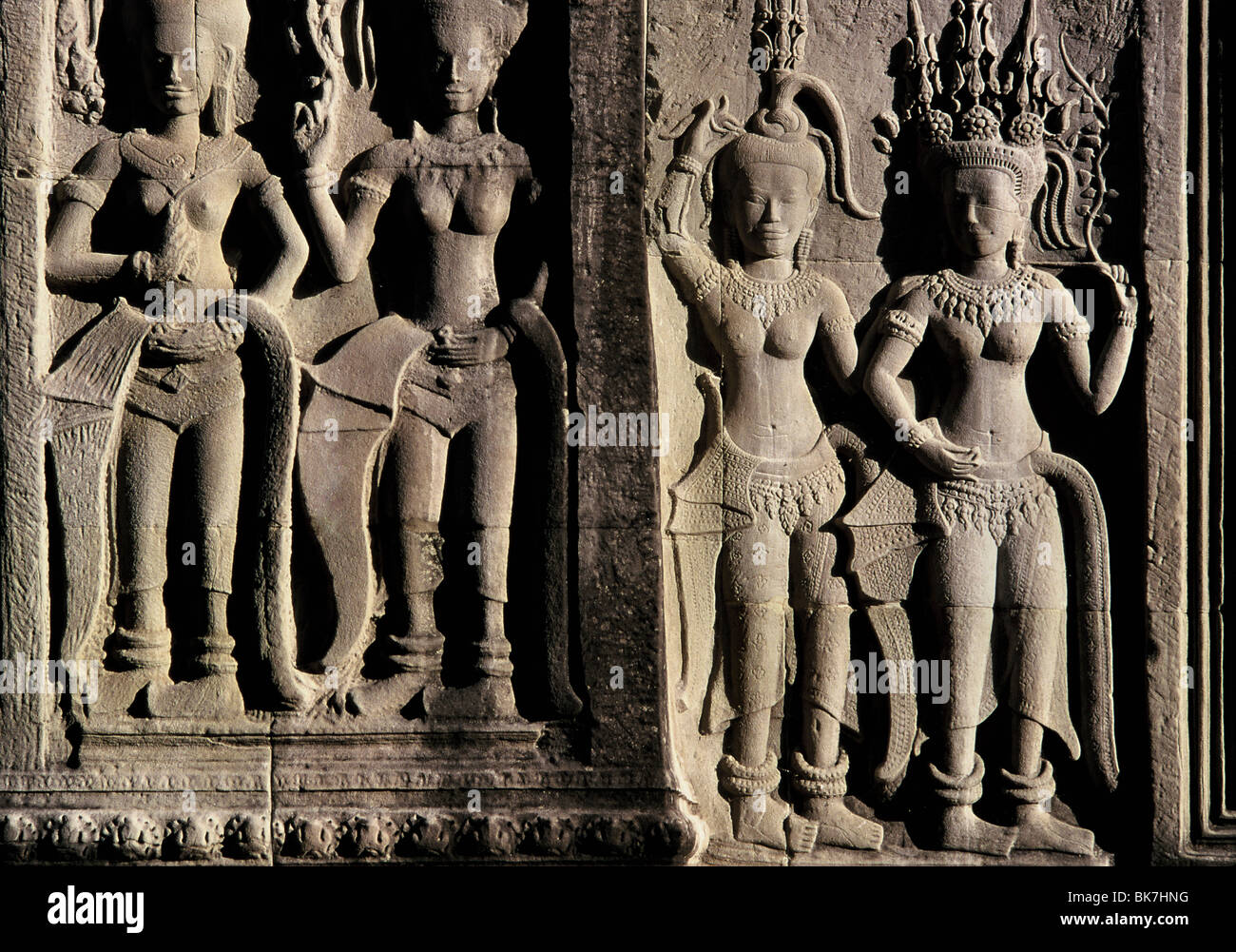 Detail of early 12th century reliefs with later additions, Angkor Wat, Angkor, UNESCO World Heritage Site, Cambodia - Stock Image