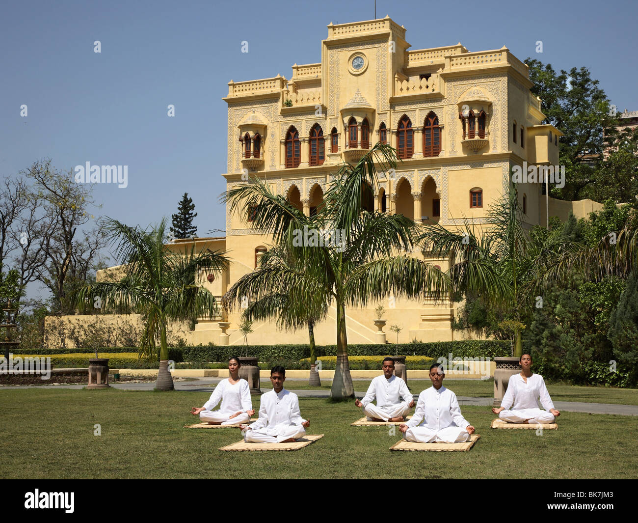Yoga on the lawn in front of palace at Ananda in the