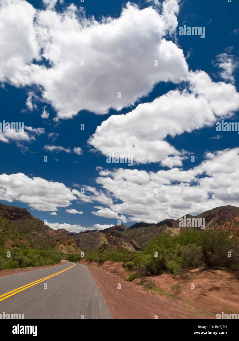 Driving on a road through a mountain landscape. - Stock Image