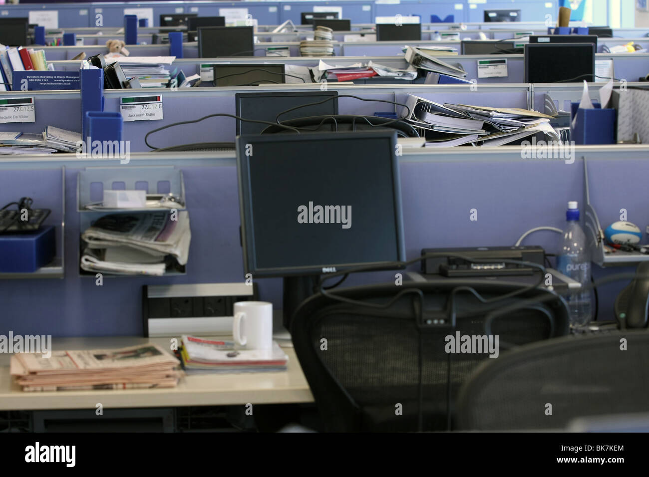 A view of part of an empty open plan bank head office on a bank holiday - Stock Image