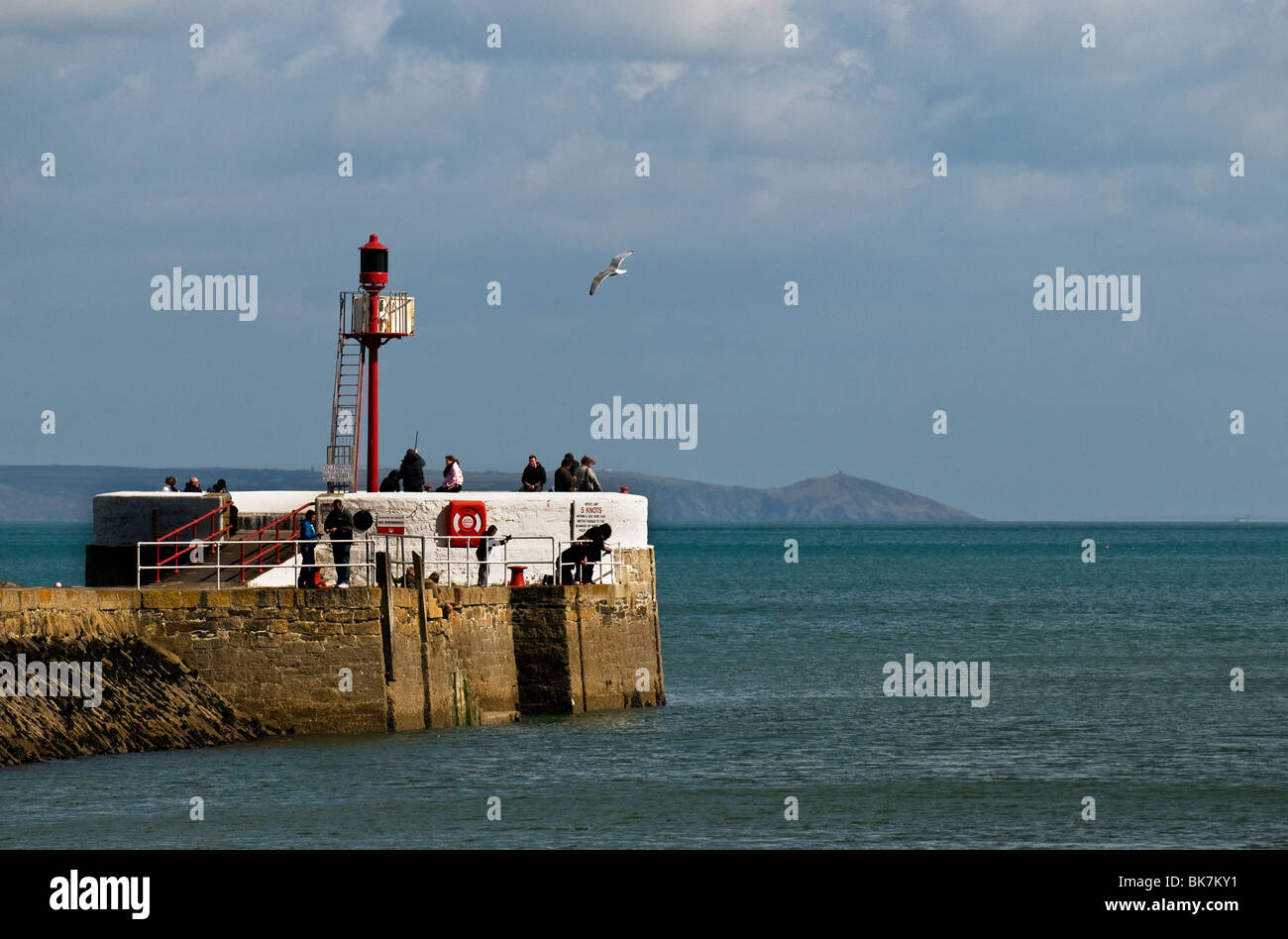 People fishing on the Banjo Pier in Looe in Cornwall.  Photo by Gordon Scammell - Stock Image