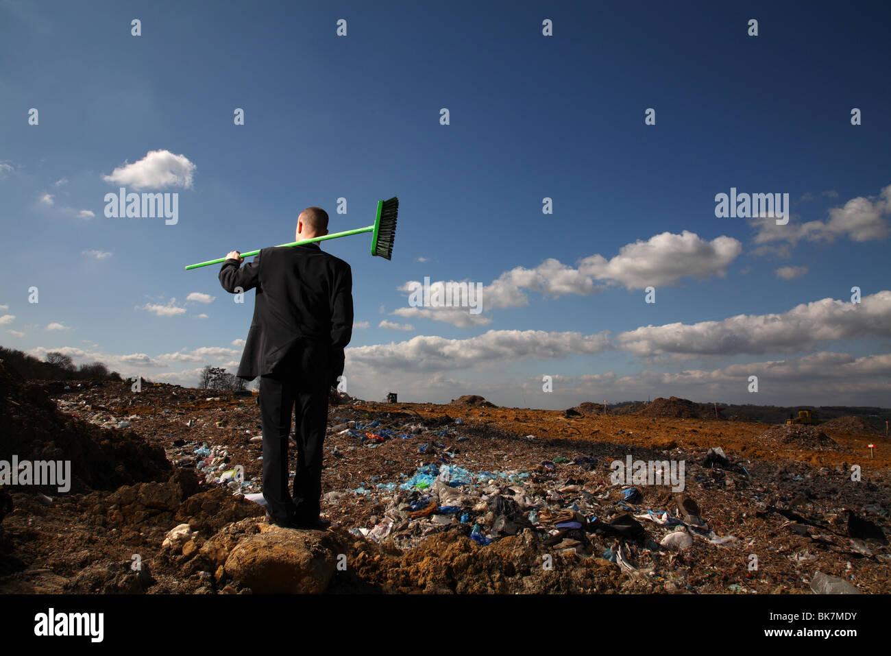 Businessman at british landfill site - Stock Image