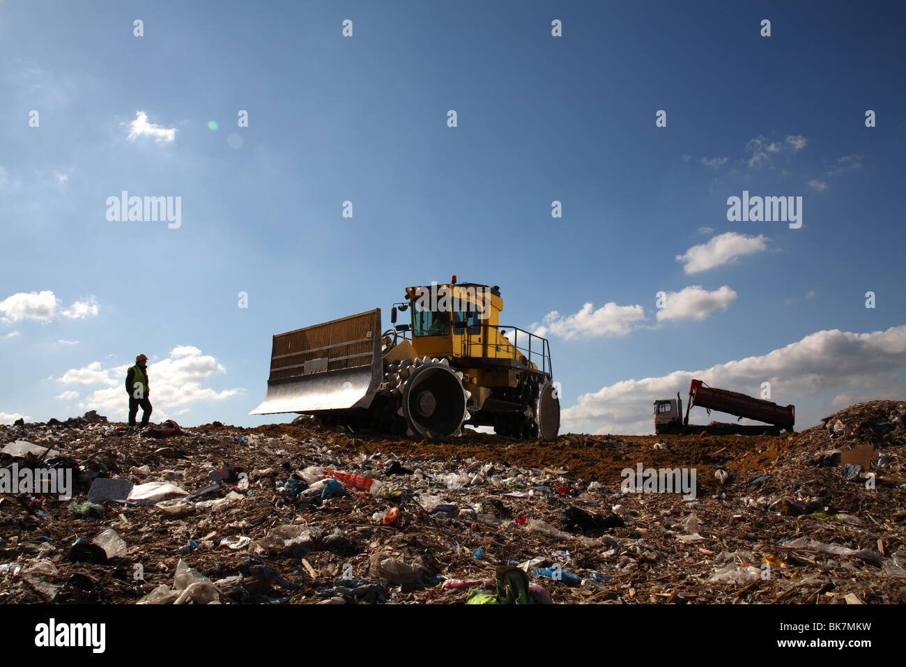 Earth mover on landfill site Stock Photo