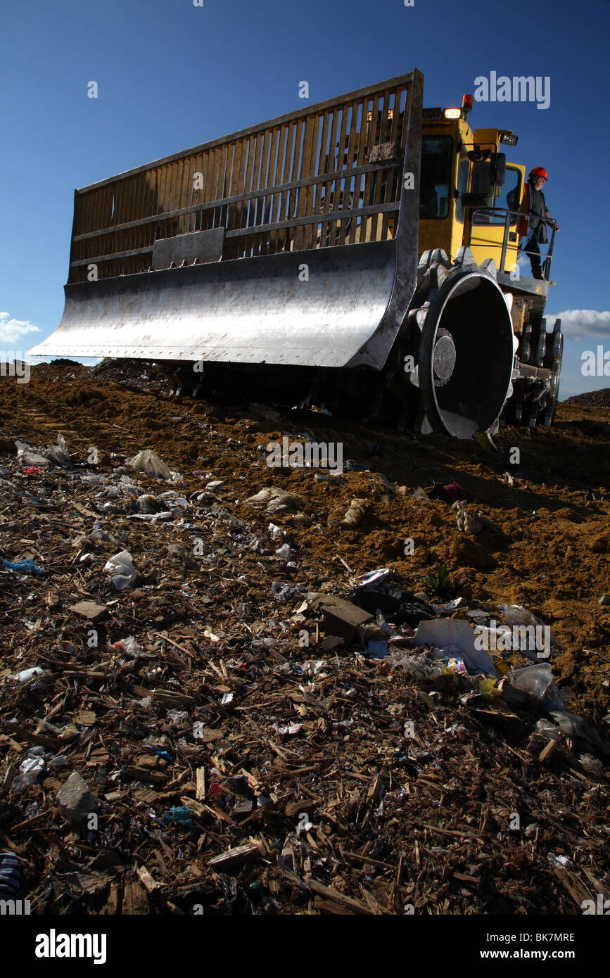 Earth mover on landfill site - Stock Image