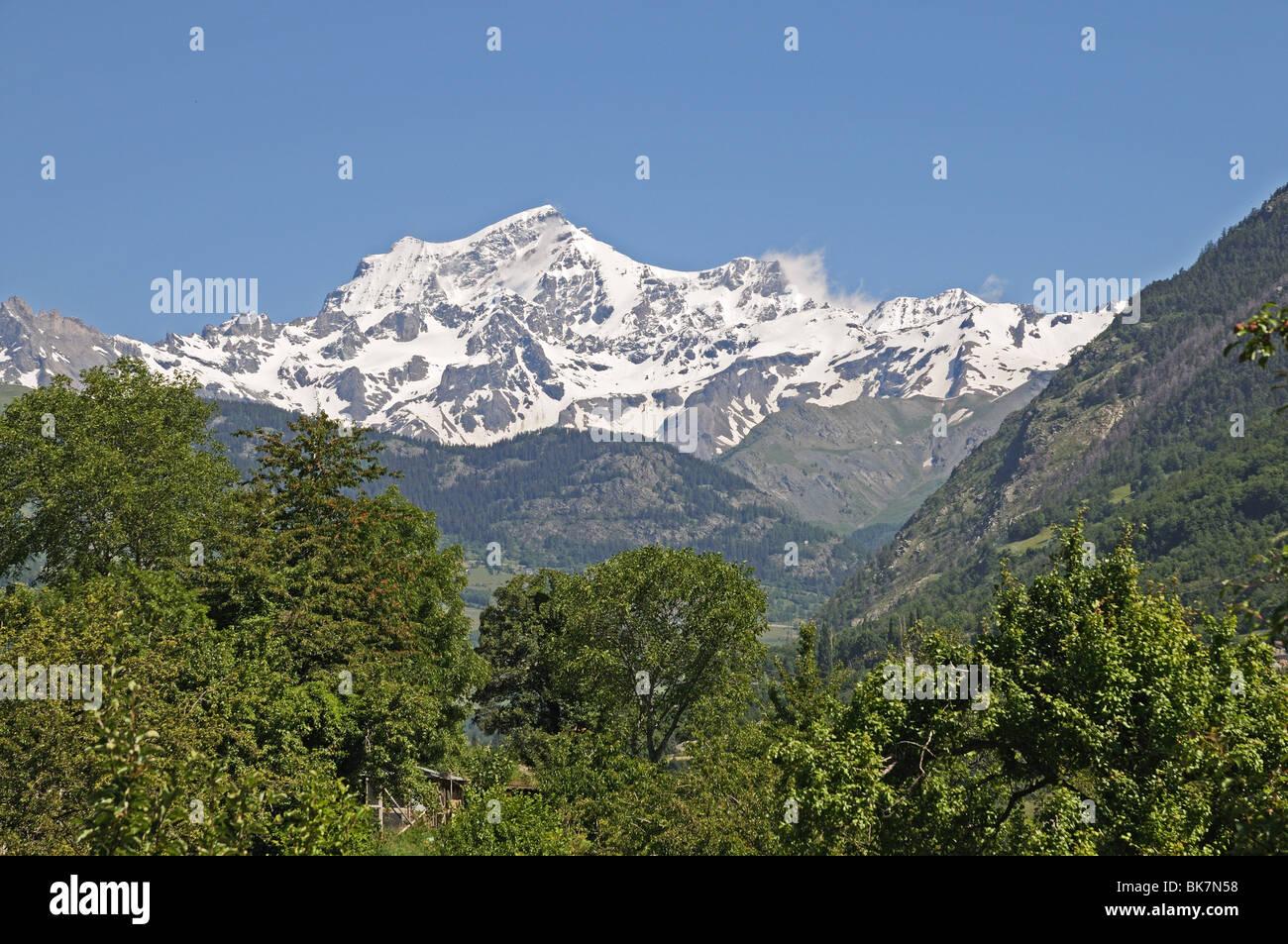 Alpine peak of Grand Combin seen from Valle del Gran San Bernardo Great St Bernard Valley north of Aosta Italy - Stock Image
