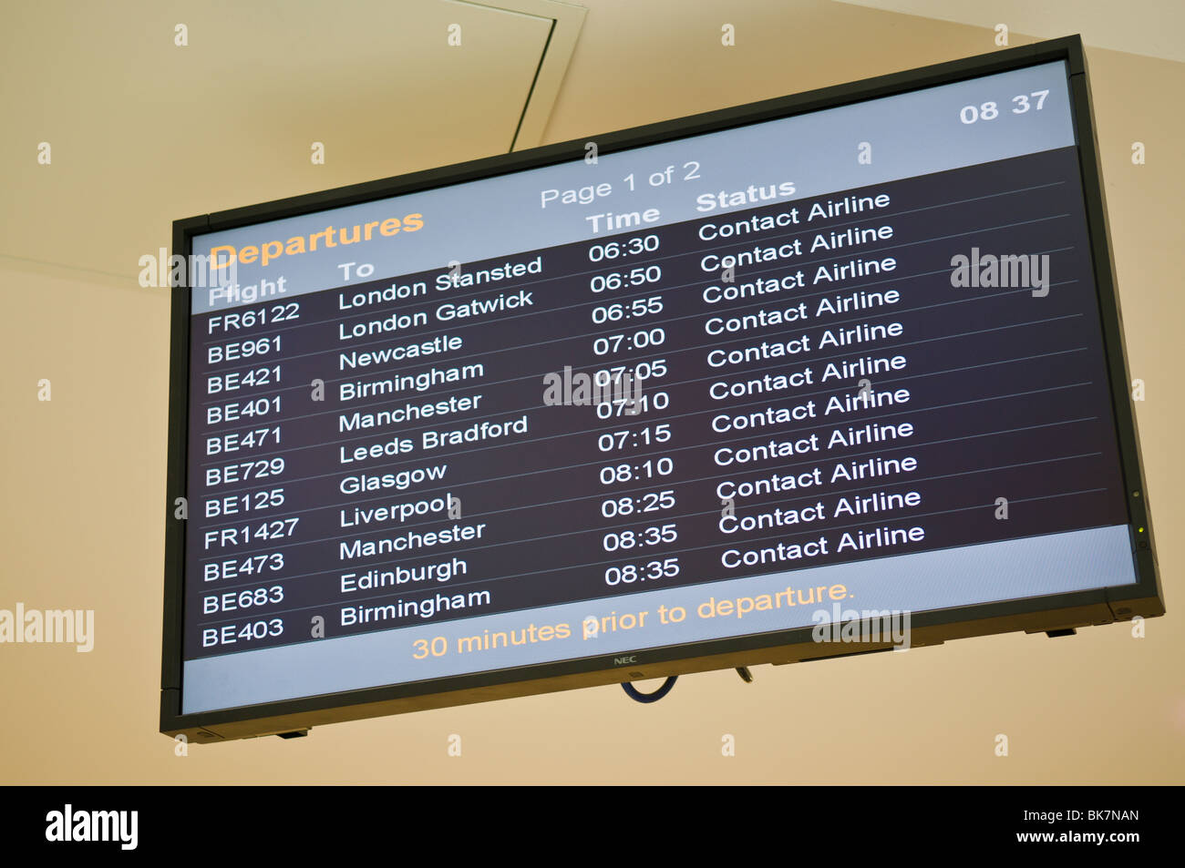 Departure board showing flights canceled, and to contact airline - Stock Image