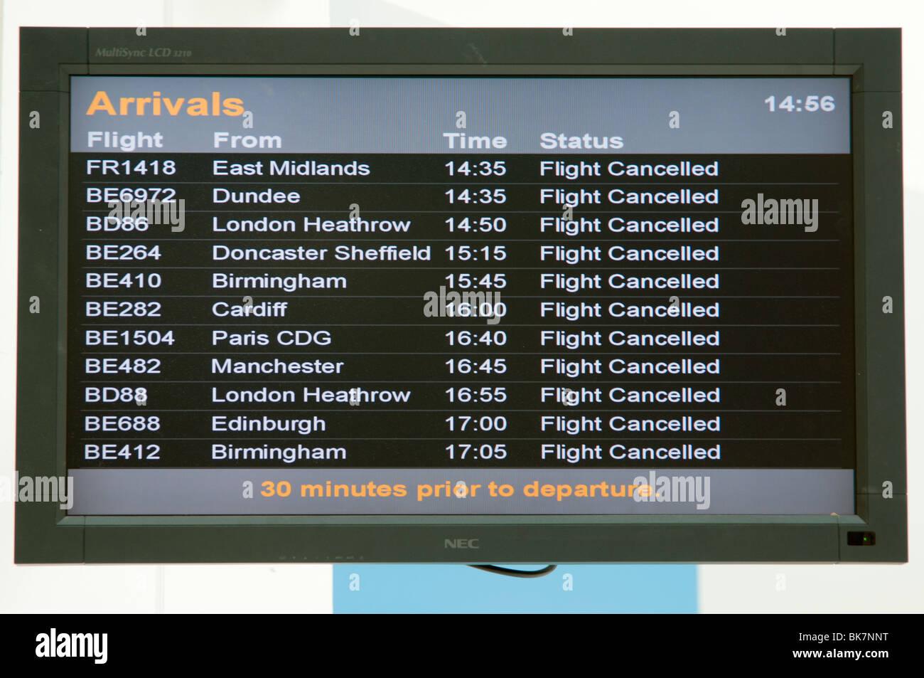Departure/Arrivals board showing flights canceled - Stock Image