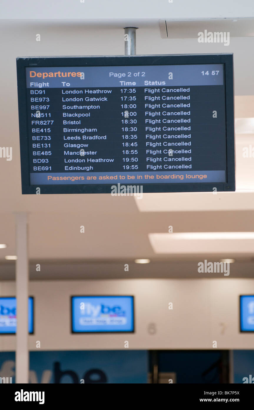 Departures board showing flights canceled - Stock Image