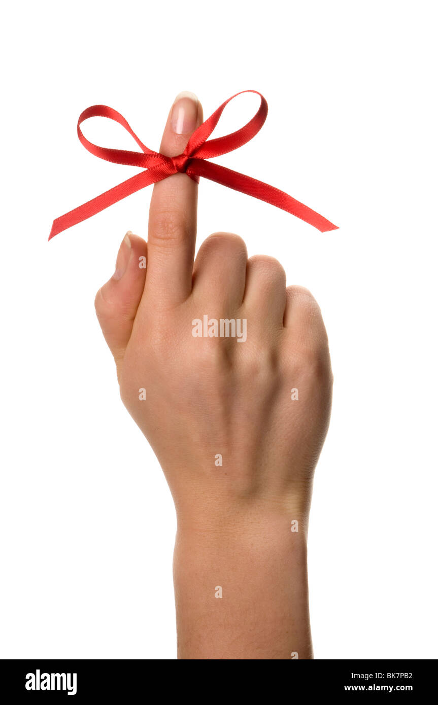 finger with ribbon - Stock Image