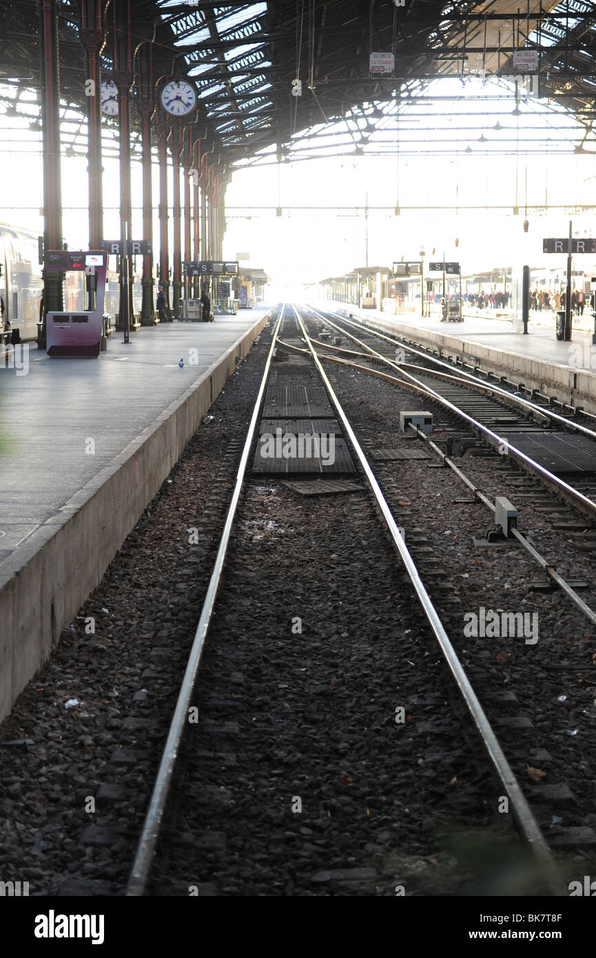 Europe France Paris train tracks in a station gare - Stock Image