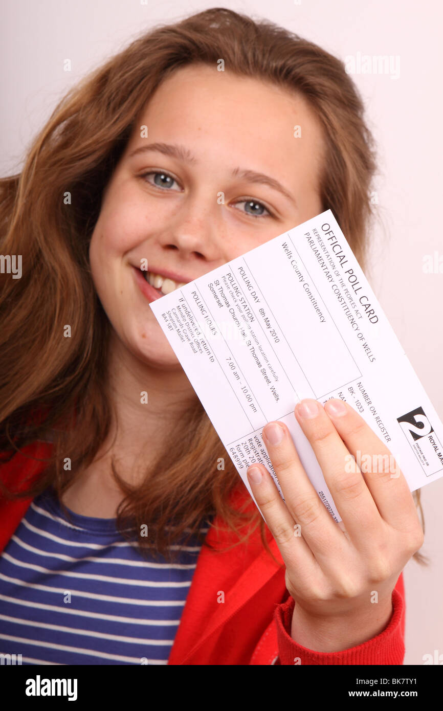 UK General Election 2010 young first time voter holding official poll voting card - Stock Image