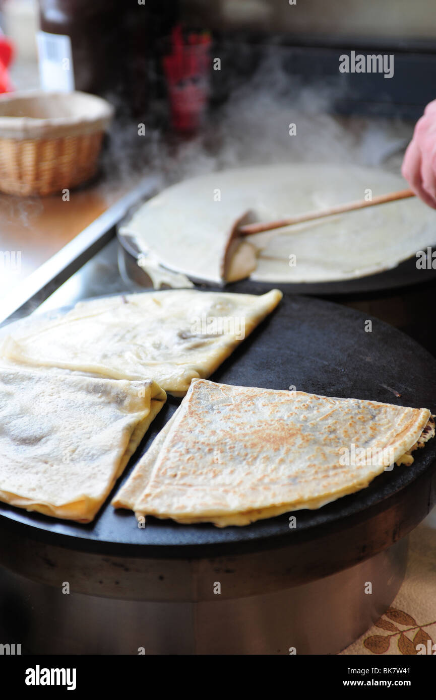 France Paris Montmartre crepe making at creperie nutella hot food dining - Stock Image