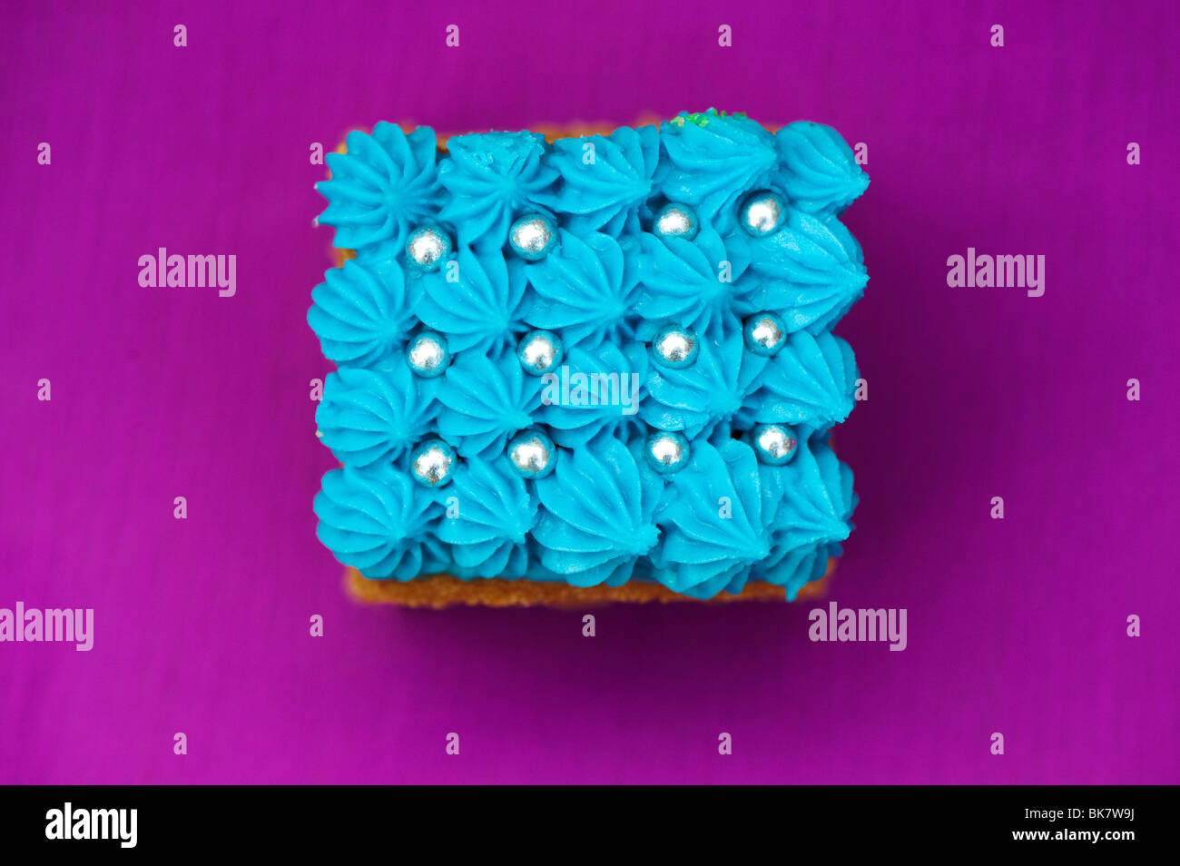 Homemade square individual iced cakes - Stock Image