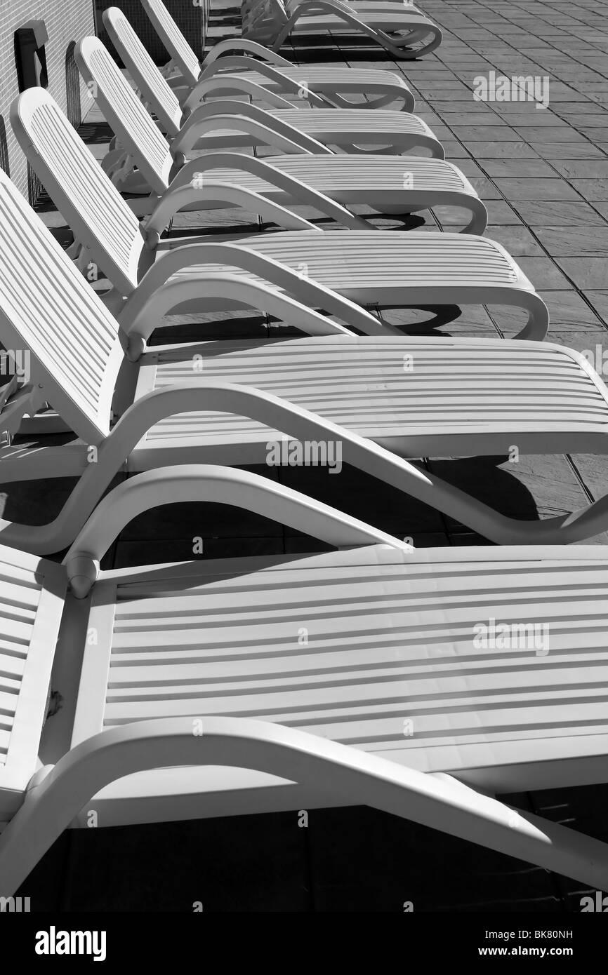 white resin solarium hammocks row black and white - Stock Image