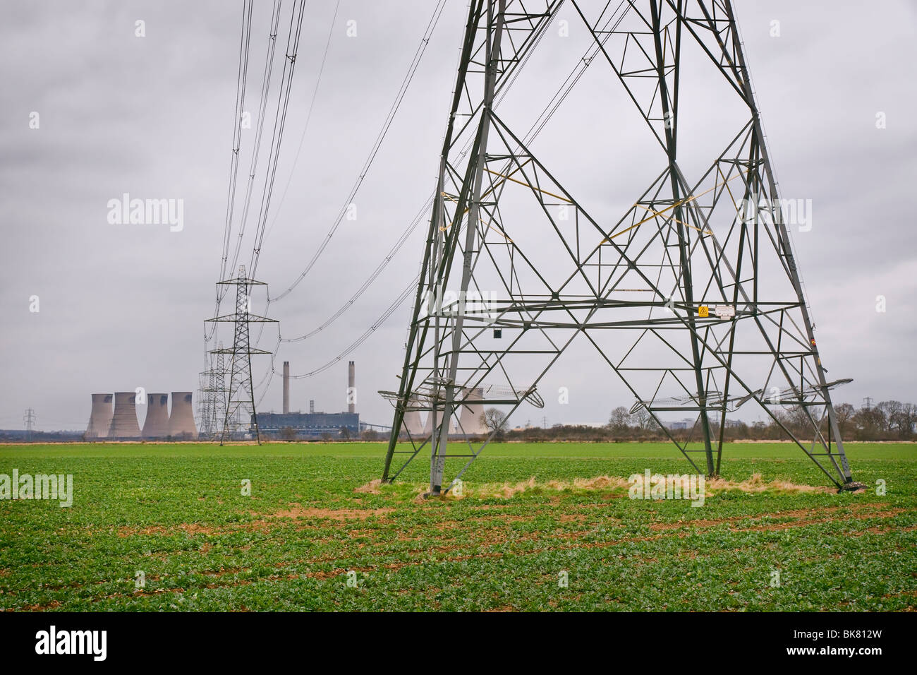Electricity pylons taking overhead cables  from the West Burton Coal Fired Power Station in Nottinghamshire. - Stock Image