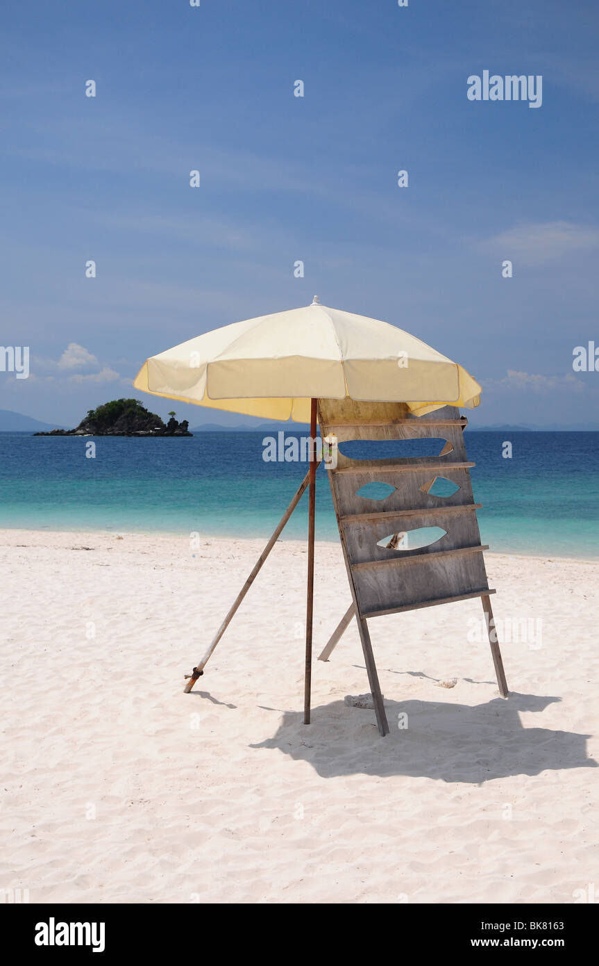 Noticeboard on deserted tropical beach - Stock Image