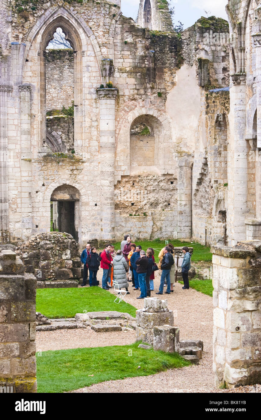 People on a guided tour around the Abbaye de Jumieges Calvados Normandy France - Stock Image