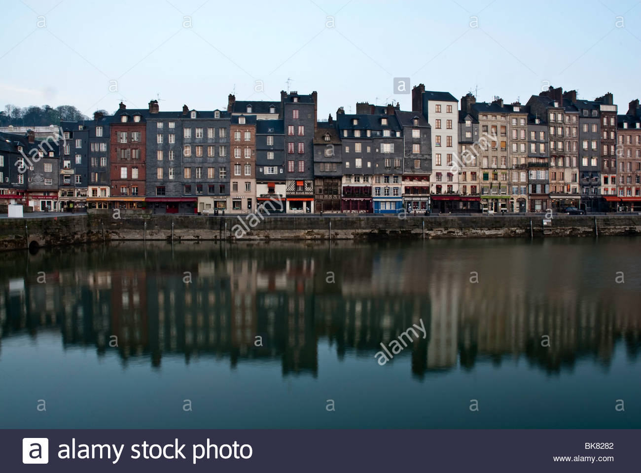 Tall houses at dawn on Vieux Bassin, Honfleur, Normandy, France - Stock Image