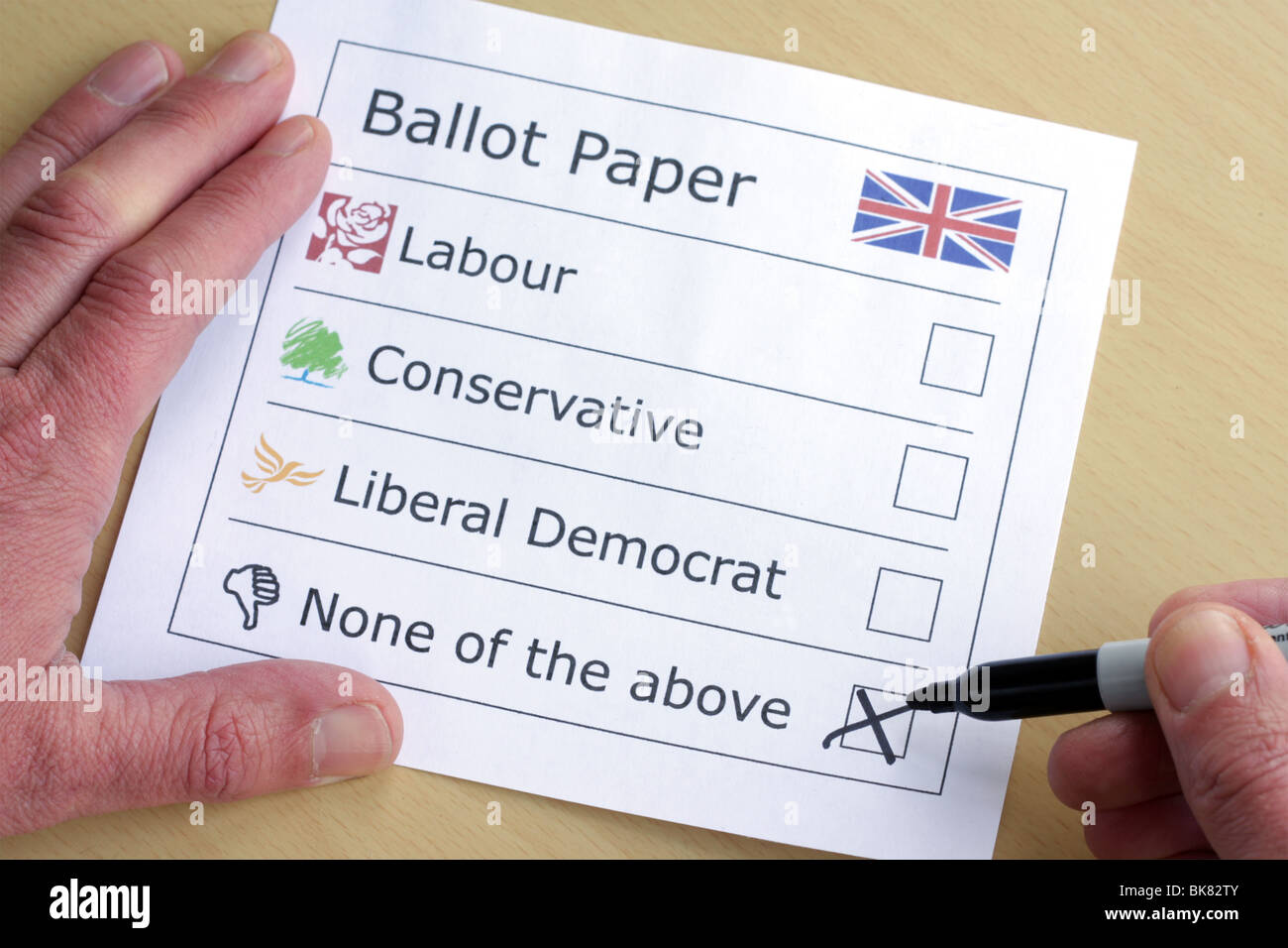 A mock ballot paper featuring the major three political parties plus none of the above. - Stock Image