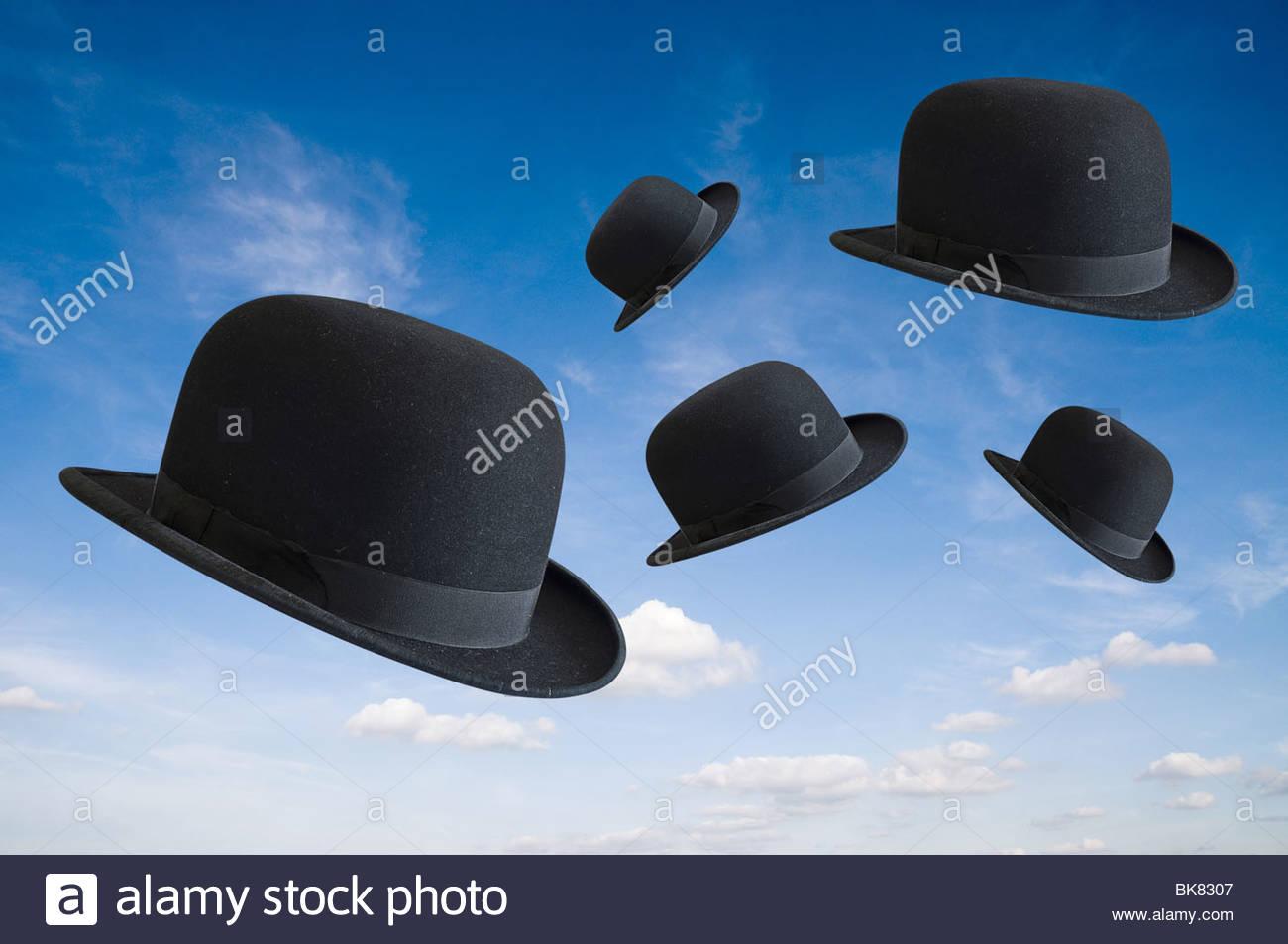 Black Bowler hats in sky - Stock Image