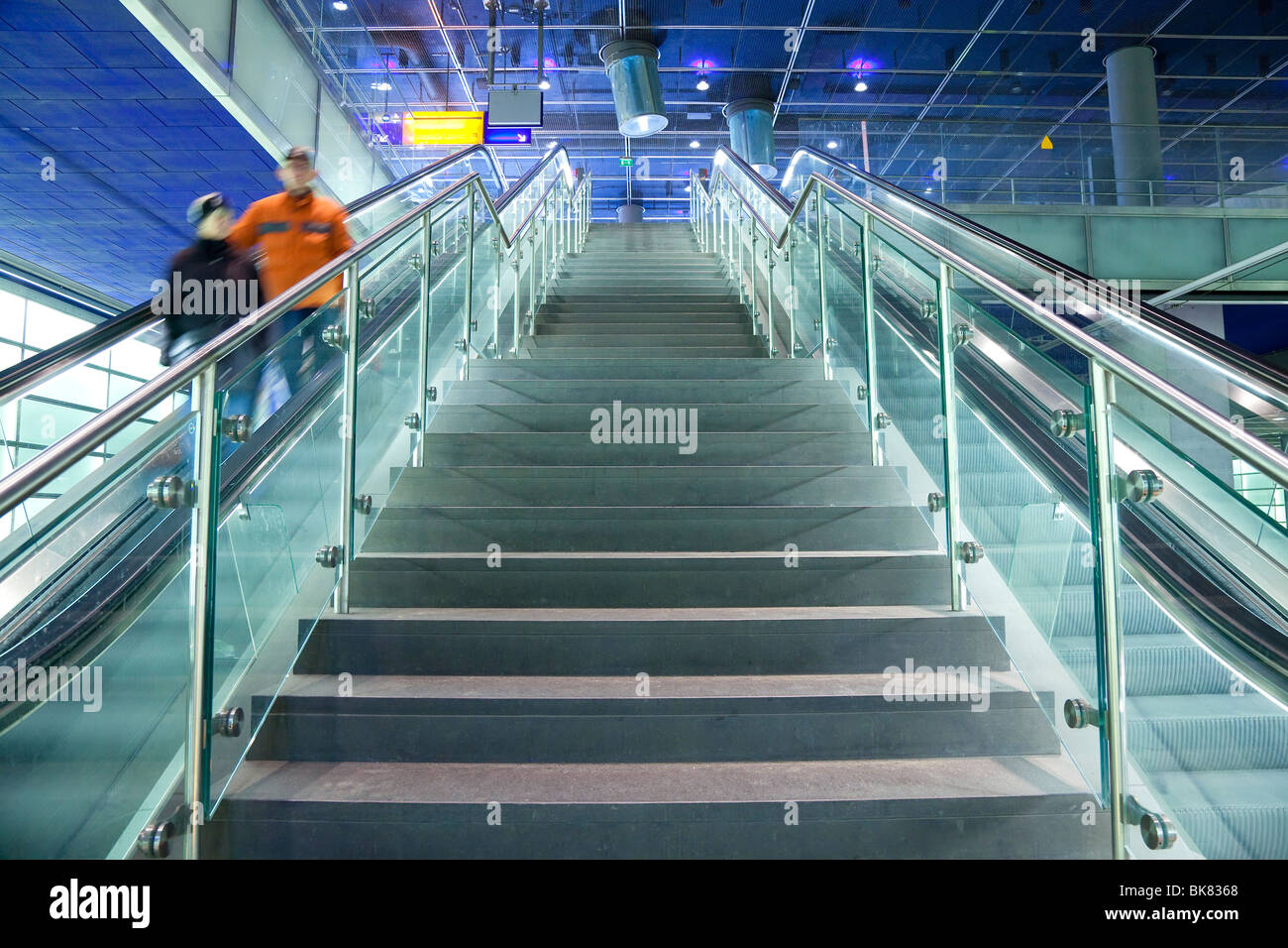 Europe, Germany, Berlin, modern train station - escalator and stairs leading to the platform - Stock Image