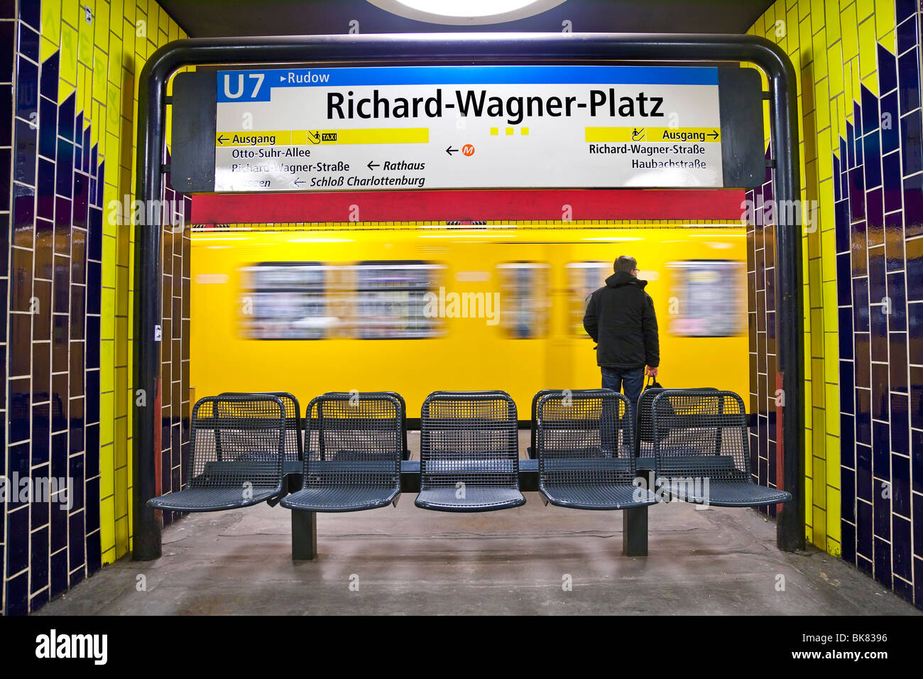 Europe, Germany, Berlin, modern subway station - moving train pulling into the station - Stock Image