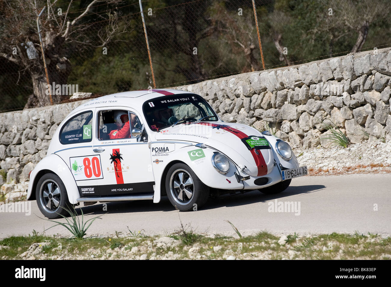 1965 VW beetle classic sports car taking part in a rally in Spain. - Stock Image