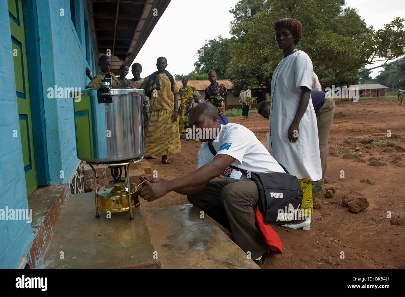 Sterilisation using a kerosene heated autoclave - Stock Image