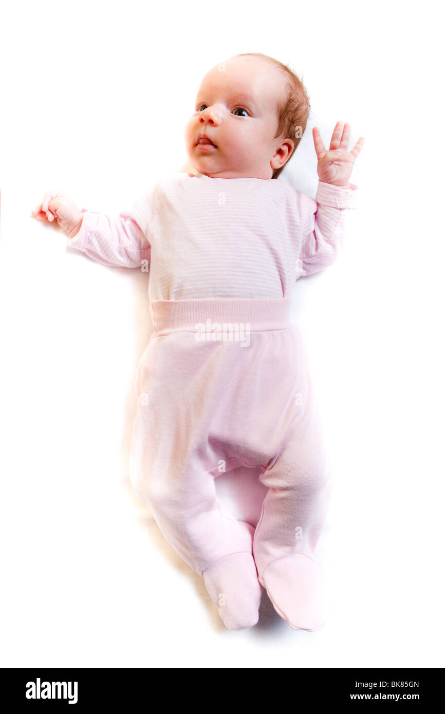 A nice small baby curiously looking around - Stock Image