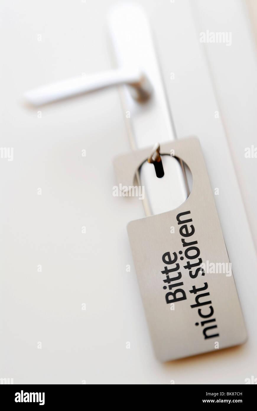 Door with a Do not disturb sign in German, Bitte nicht stoeren Stock Photo