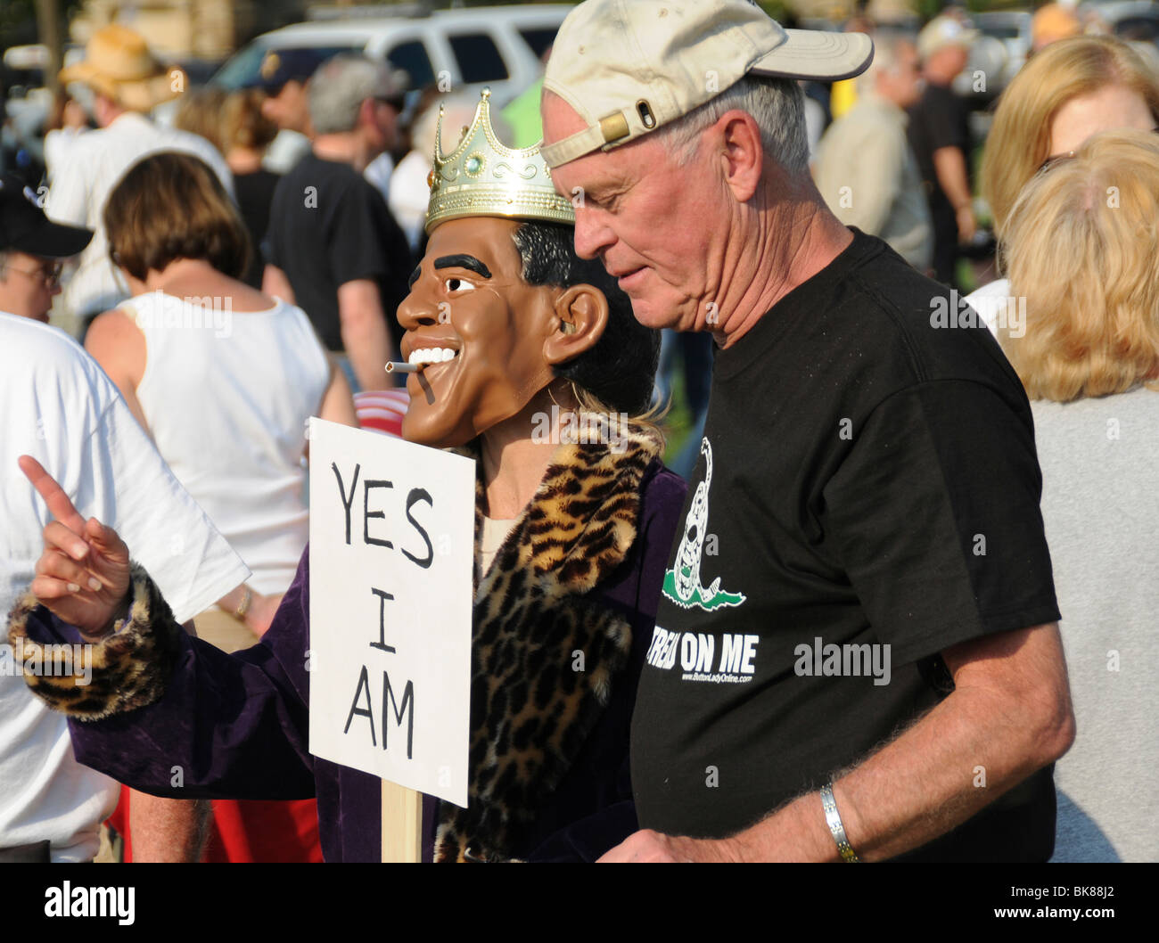 tea party protester with someone wearing a Barrack Obama mask at a Tea Party protest in Washington DC - Stock Image