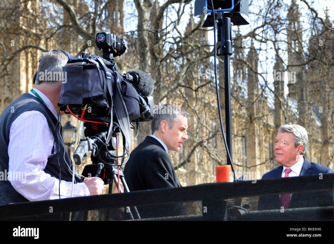 Sky News TV presenter Dermot Murnaghan interviewing Home Secretary Alan Johnson on podium outside Parliament - Stock Image